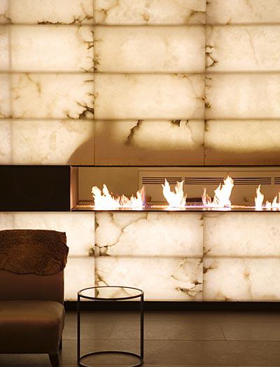 Hotel interior design. Alabaster fireplace.